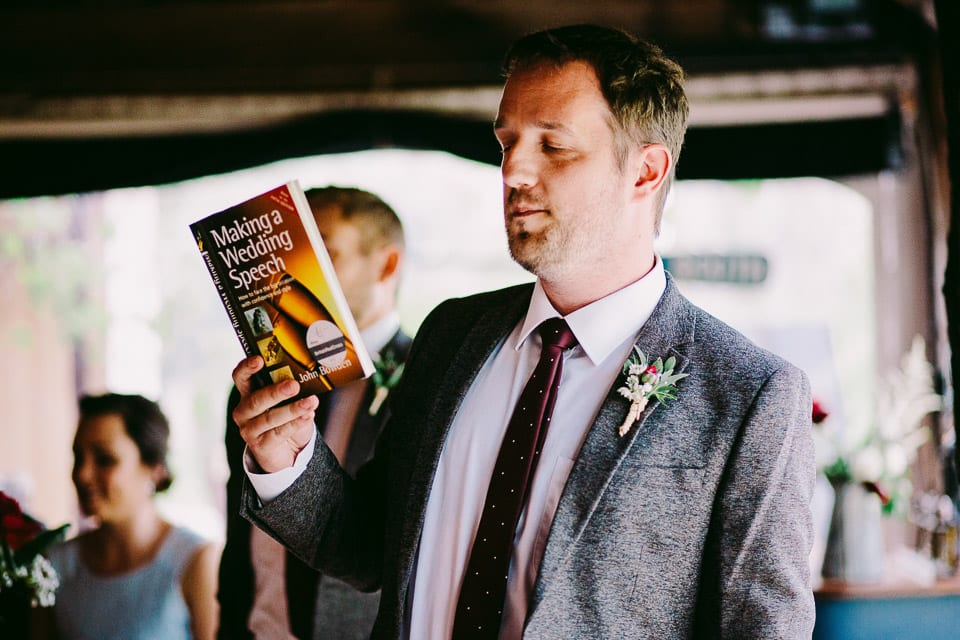 Best man holding 'Making a Wedding Speech' book