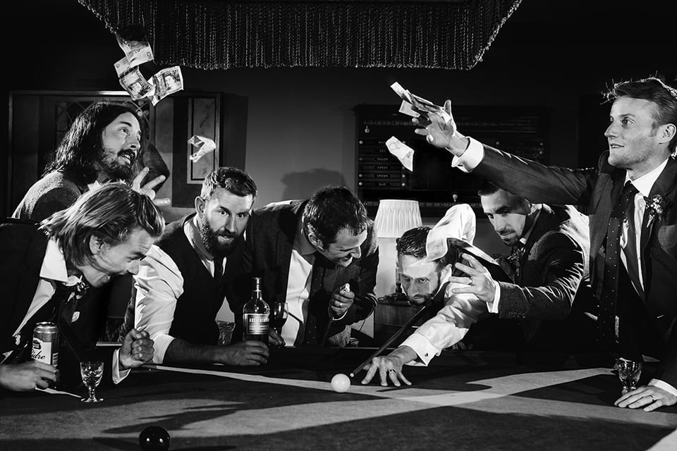 Black and white image of the men playing snooker