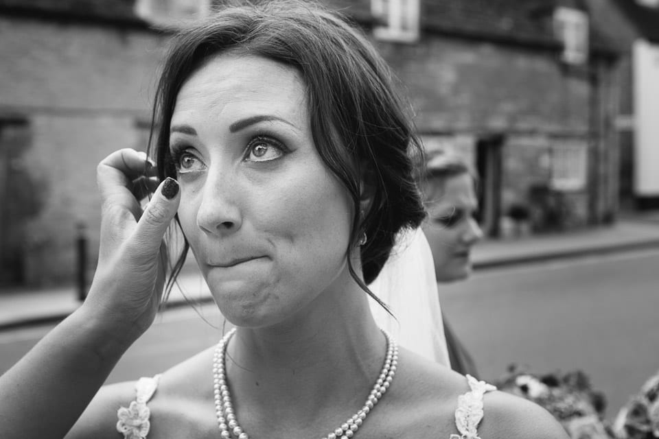 Emotional bride before going into church