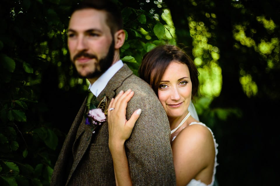 Close up image of bride and groom in woods