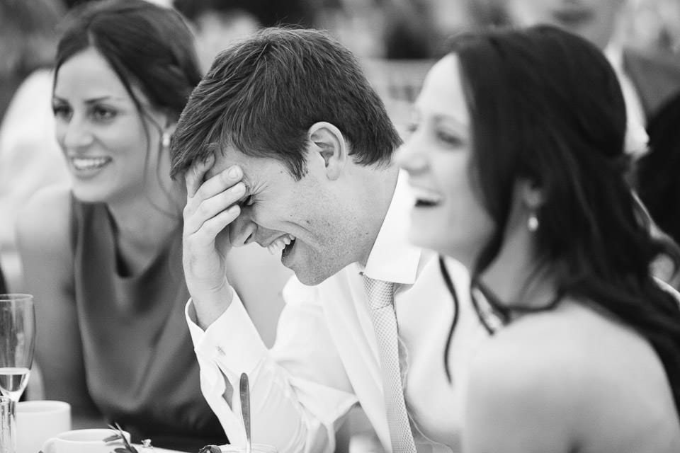 Black and white image of couples reaction to best man speech
