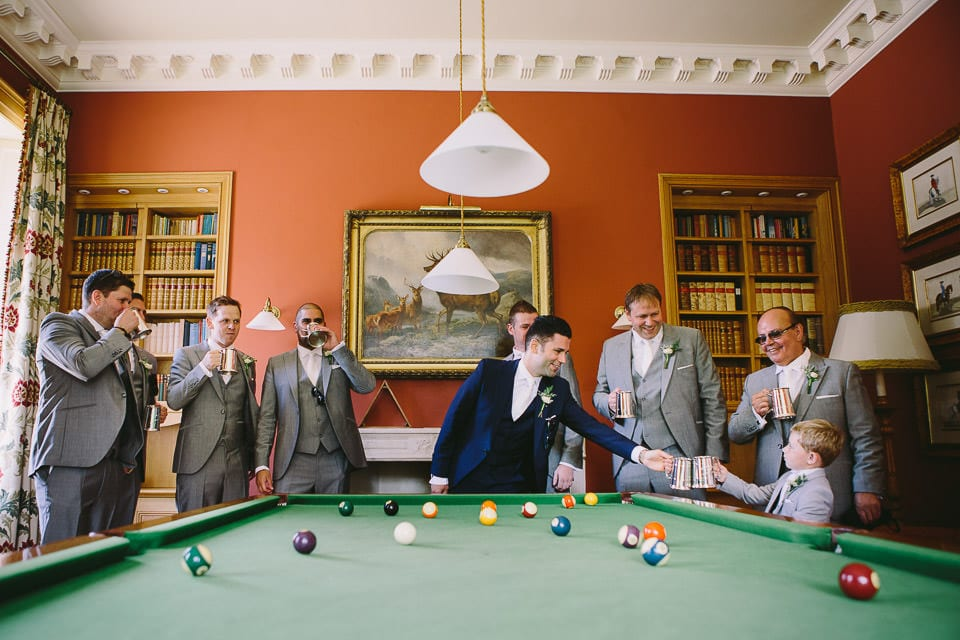 Groom and his groomsmen in the snooker room