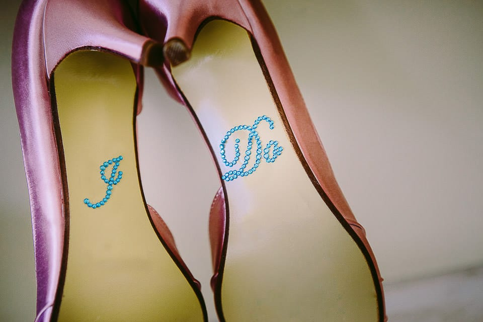 Close up of bottom of brides shoes