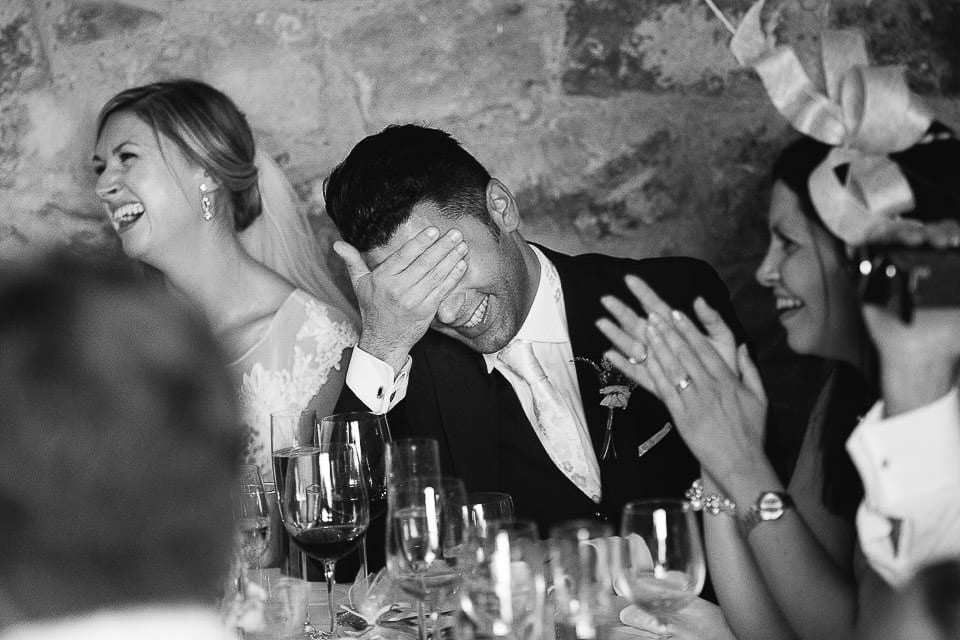 Black and white image of grooms reaction to best man speech