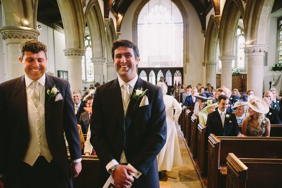Groom and best man waiting in church for bride