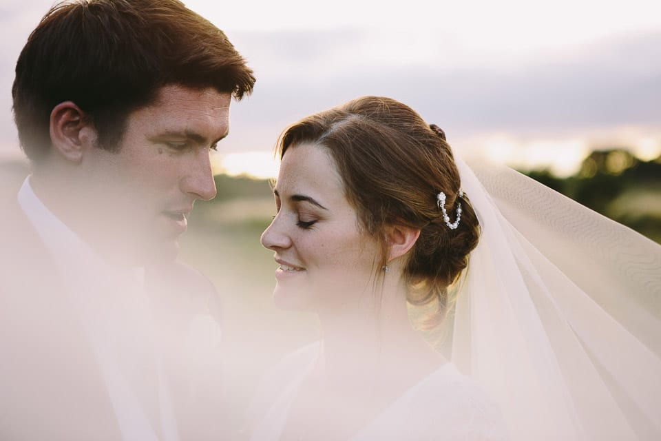 Close up shot of bride and groom in countryside