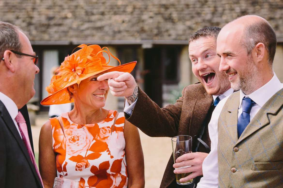 Groom and guests having a laugh