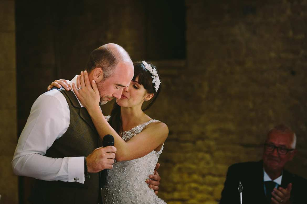 Bride kissing groom after his speech