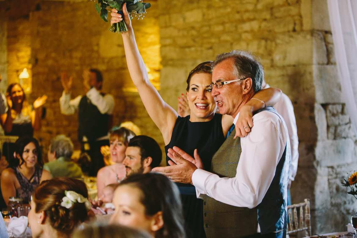 Father of the bride and bridesmaid during speeches