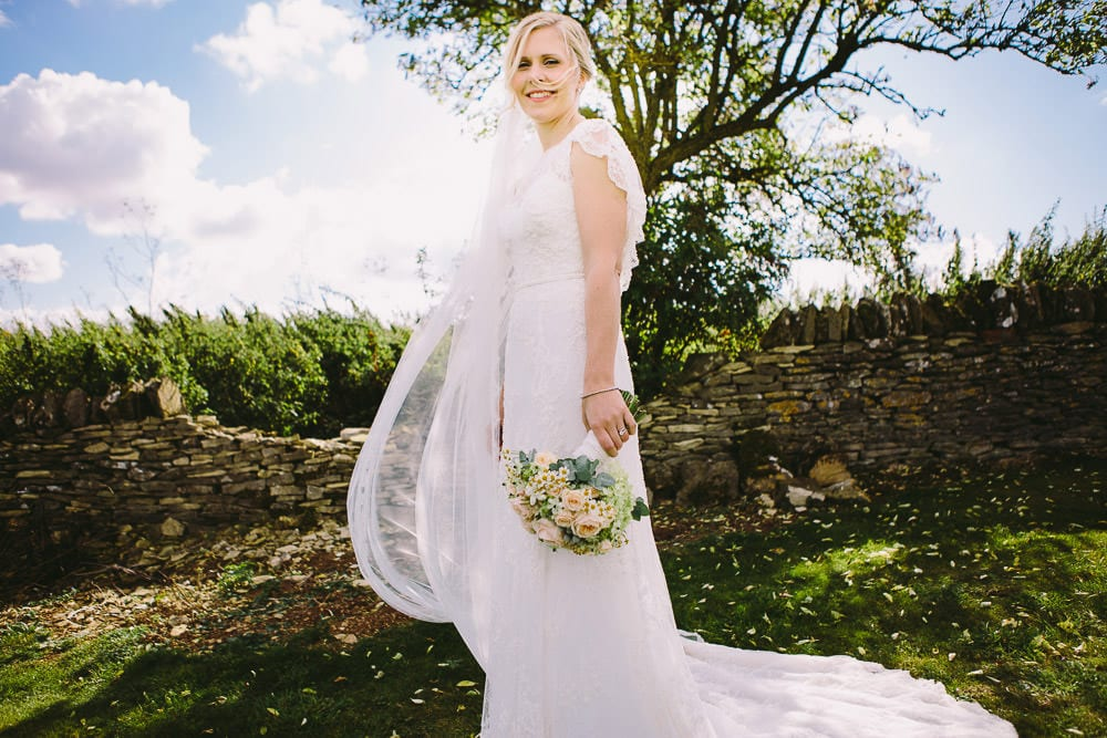Portrait of the bride in the gardens of Cripps Stone Barn