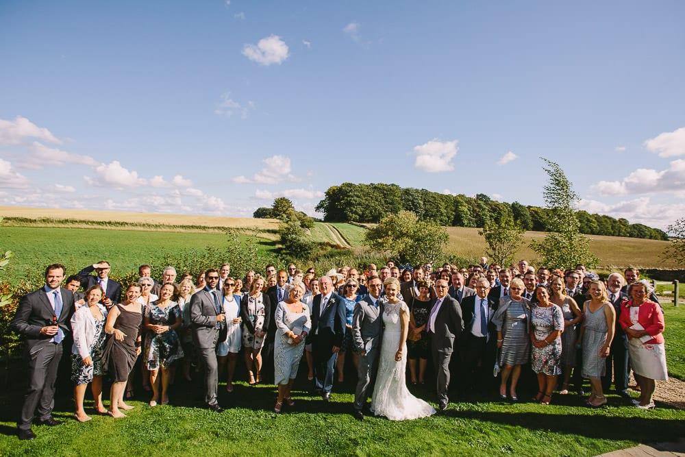 Group shot of everyone at the Cripps Stone Barn wedding