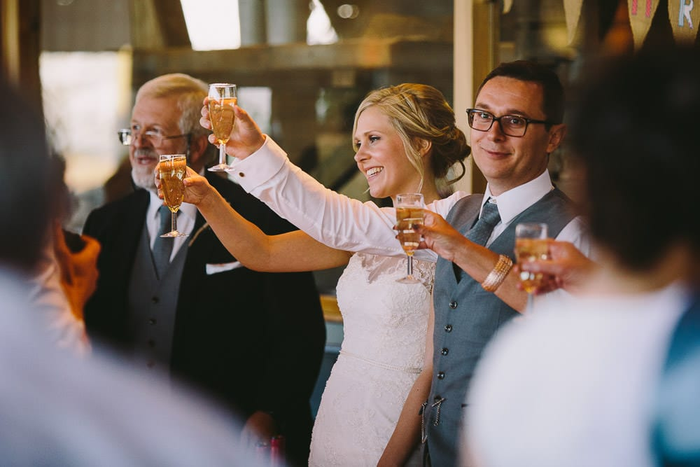 Bride and groom giving a toast with the guests at Cripps Stone Barn
