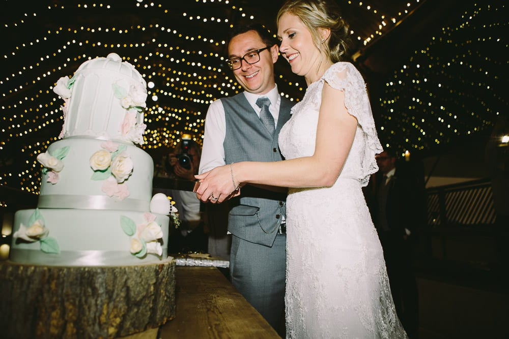 Bride and groom cutting the wedding cake at Cripps Stone Barn