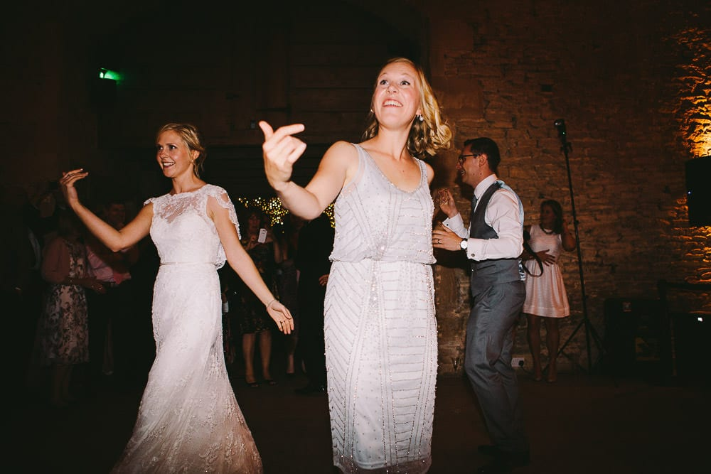 Bridesmaid beckoning people onto the dance floor in Cripps Stone Barn