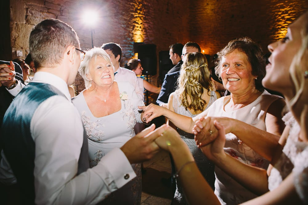 Guests dancing in the stone barn at Cripps Stone Barn