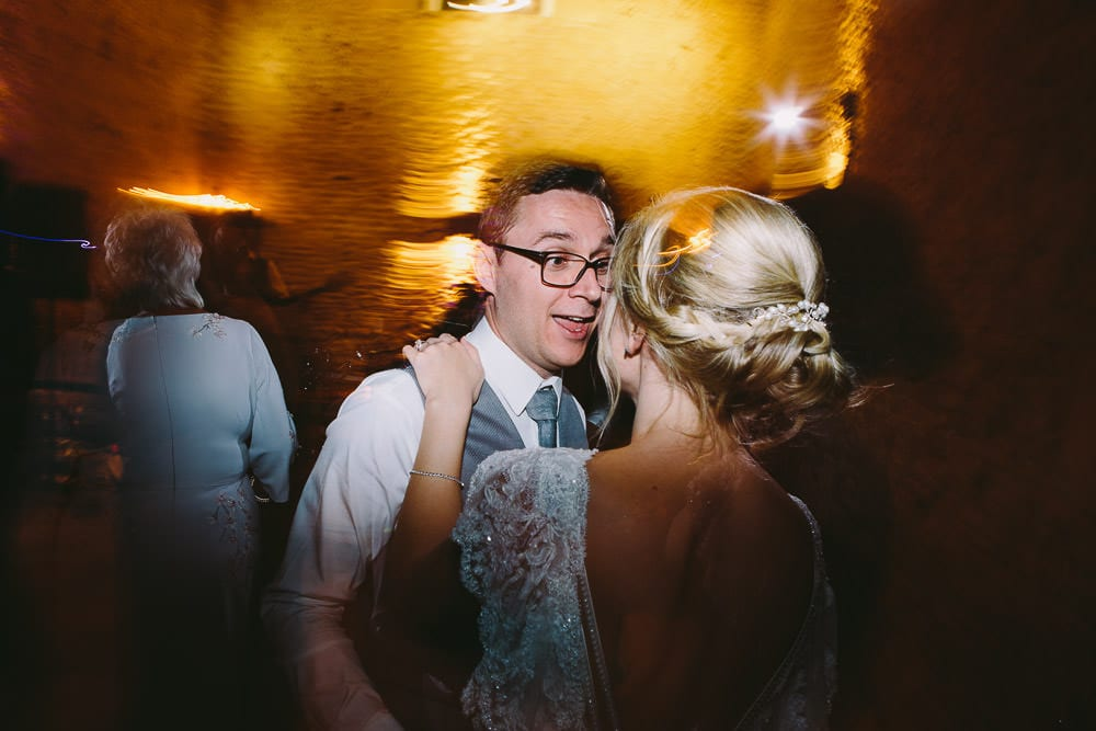 Bride and groom dancing with their guests at Cripps Stone Barn