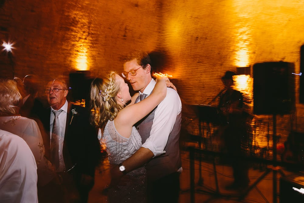 Bridesmaid dancing with her other half at Cripps Stone Barn