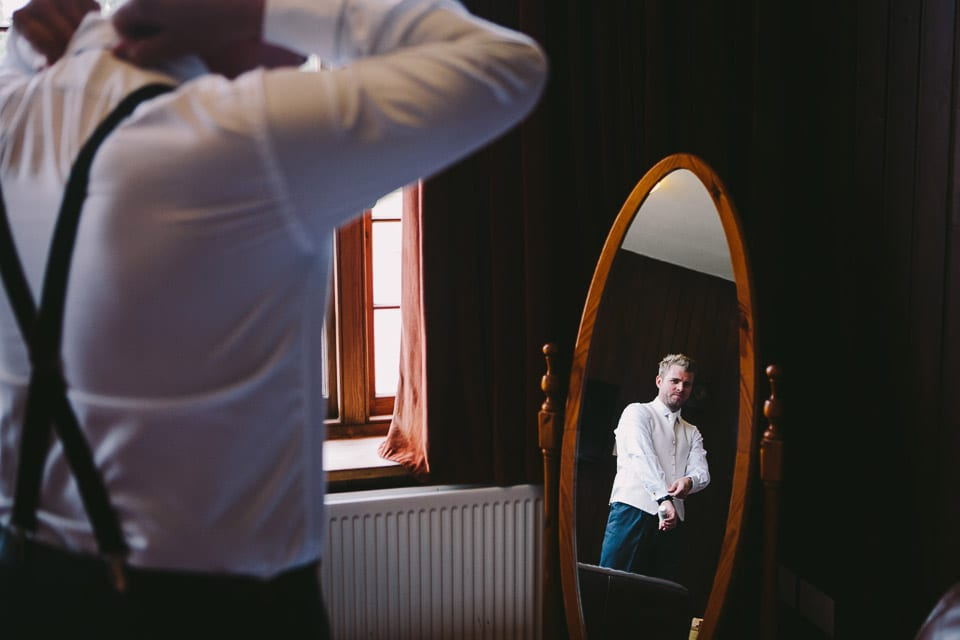 Image of best man in mirror