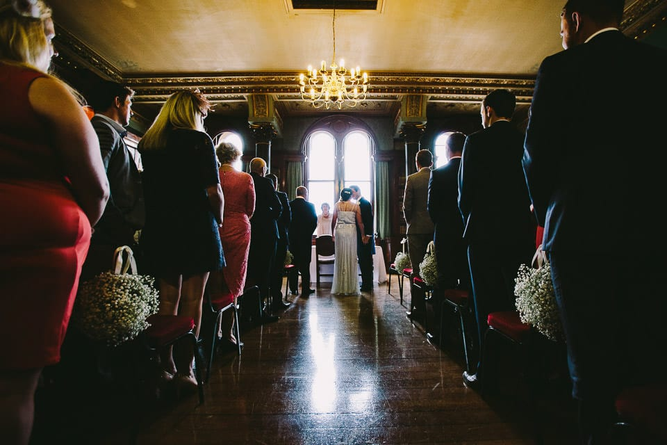 Full length image of bride and groom kissing during ceremony