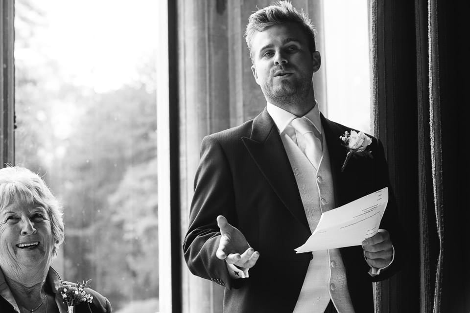 Black and white image of best man doing speech