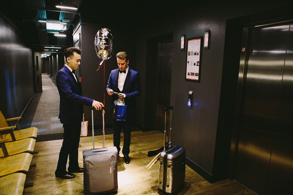 Both grooms waiting for the lift in The Hoxton London