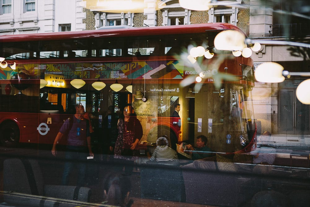 Reflection of double decker bus in window of The Hoxton London