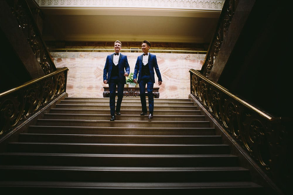 Grooms walking down the main staircase in Wandsworth Town Hall