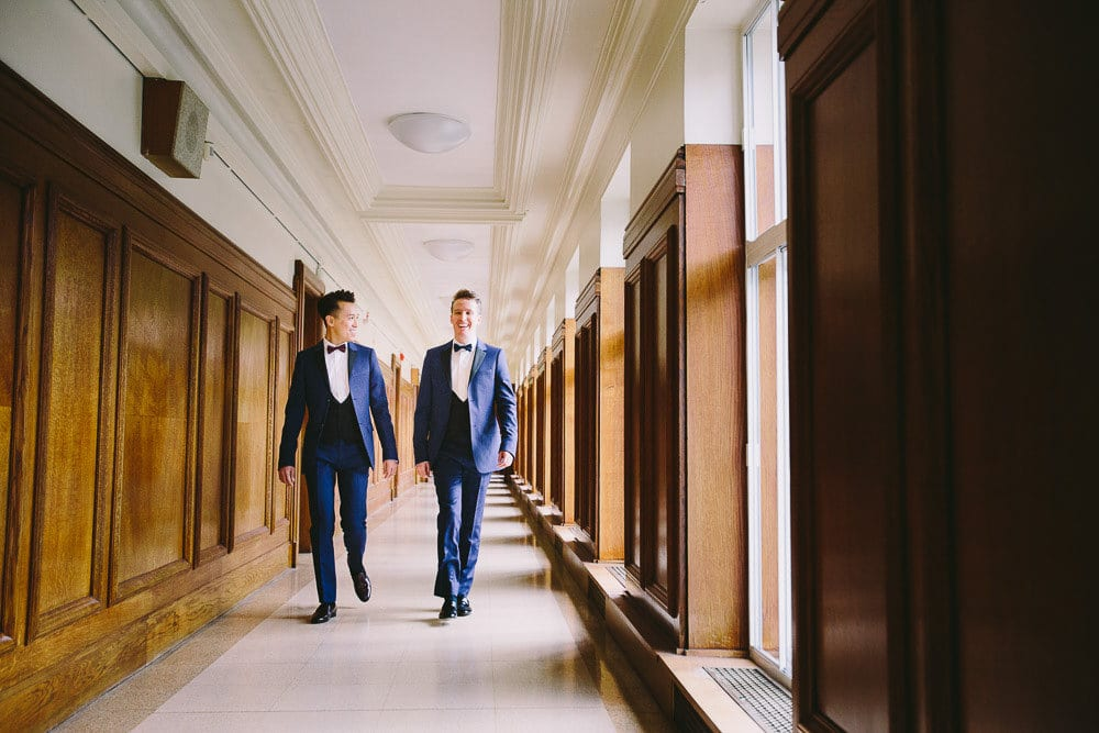 Grooms walking down the corridor in Wandsworth Town Hall