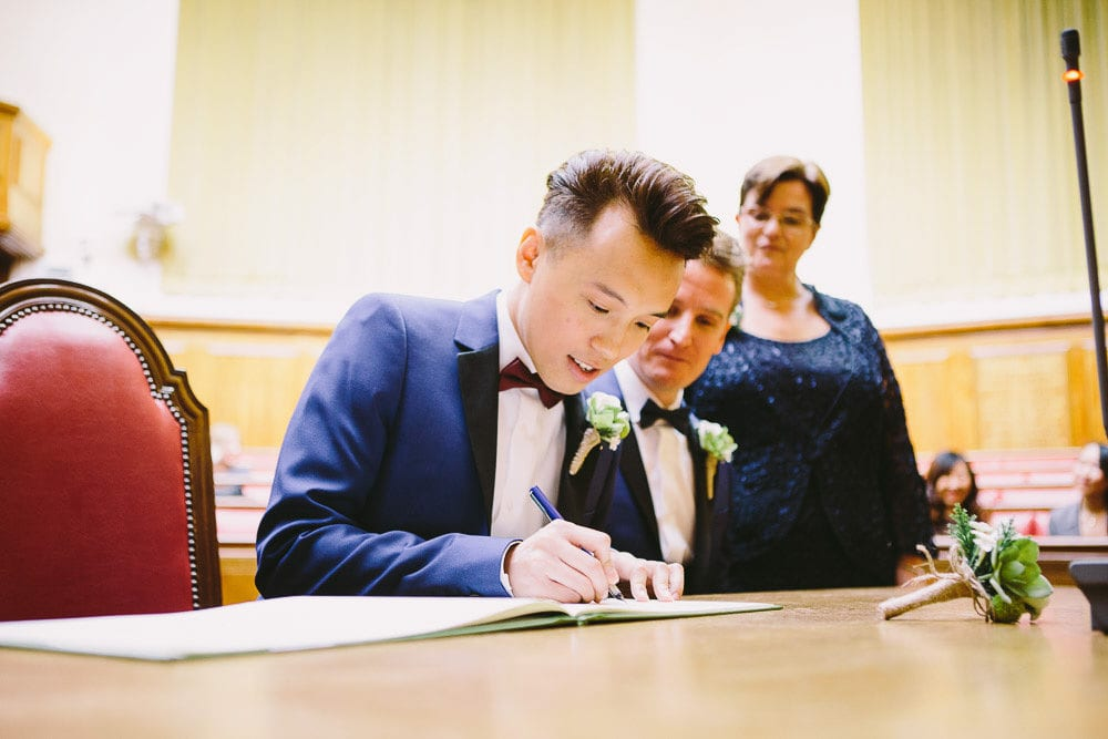 Groom signing the register in the Grand chamber at Wandsworth Town Hall