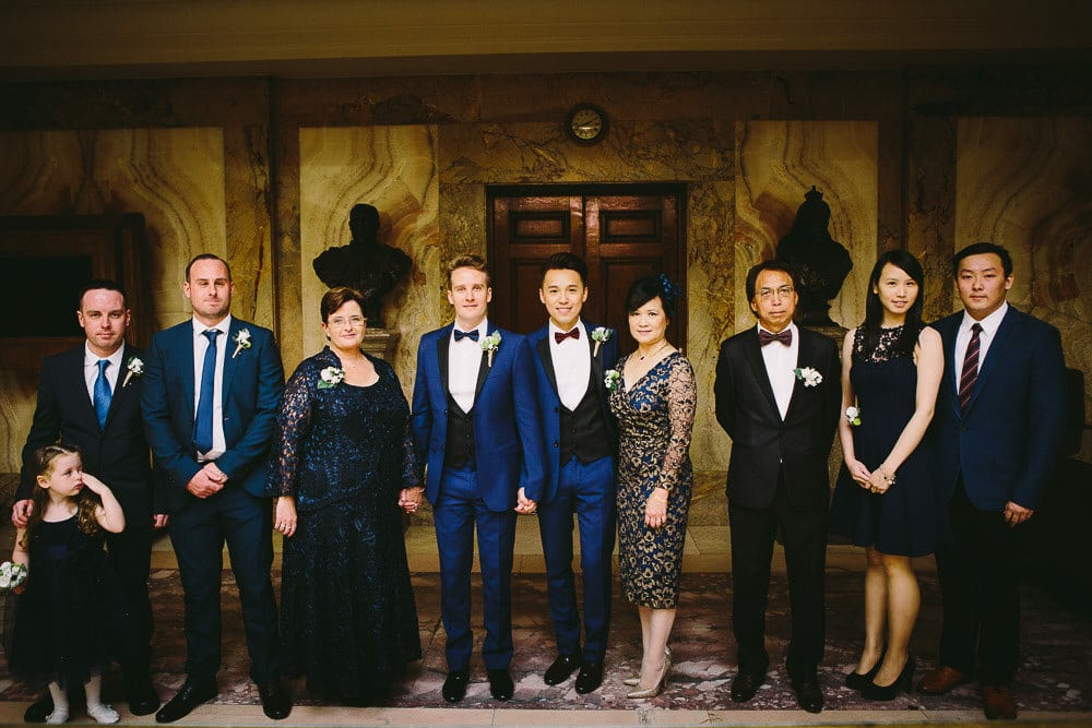 Grooms and their immediate families in the marble hall at Wandsworth Town Hall