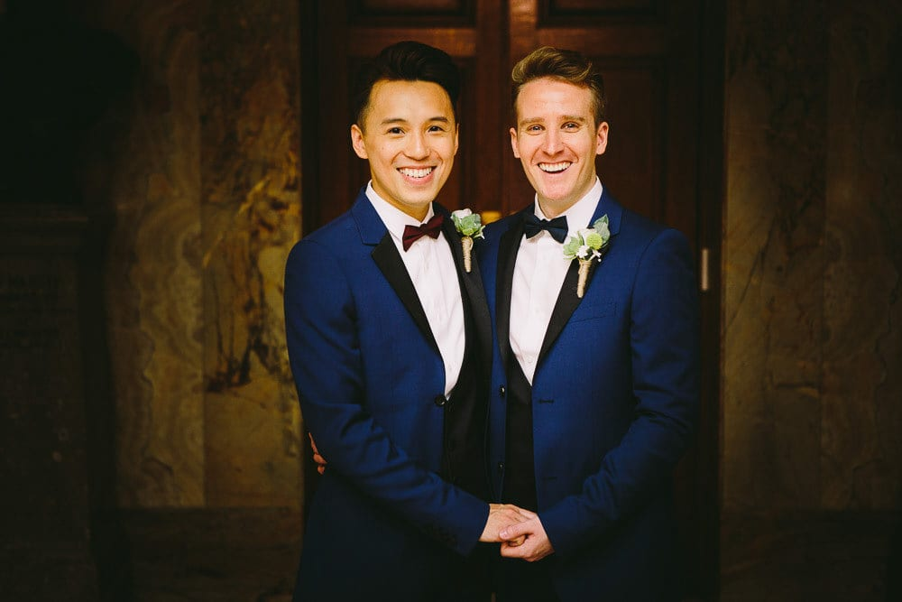 Portrait of grooms in the marble hall at Wandsworth Town Hall
