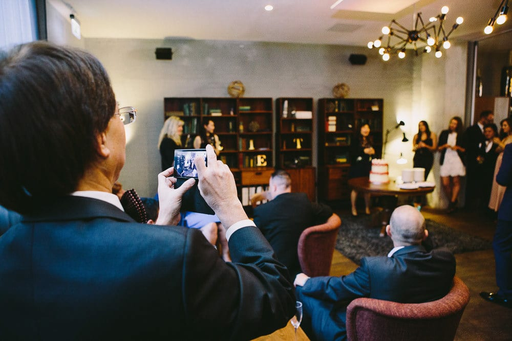 Father of the groom filming the speech at The Hoxton London