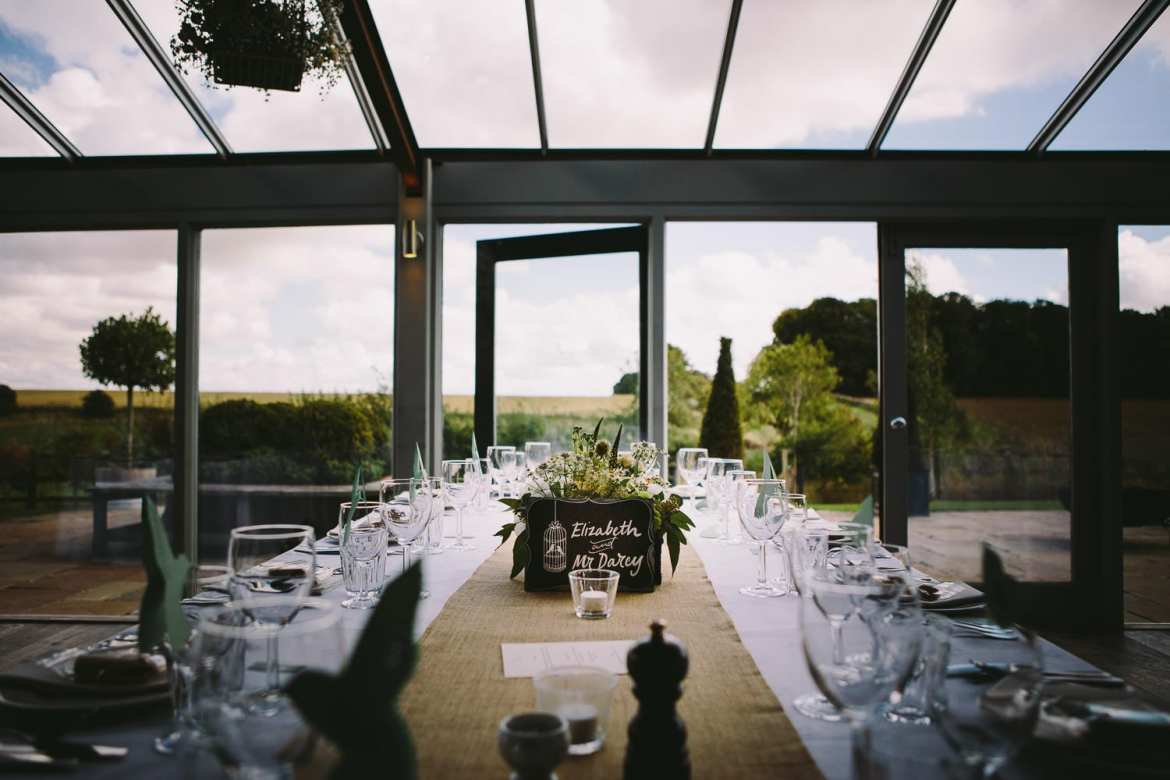 Table set for wedding breakfast with view over countryside