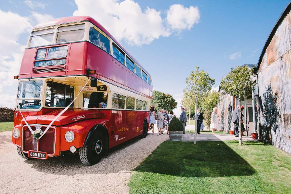 Guests disembarking vintage bus at Cripps Stone Barn