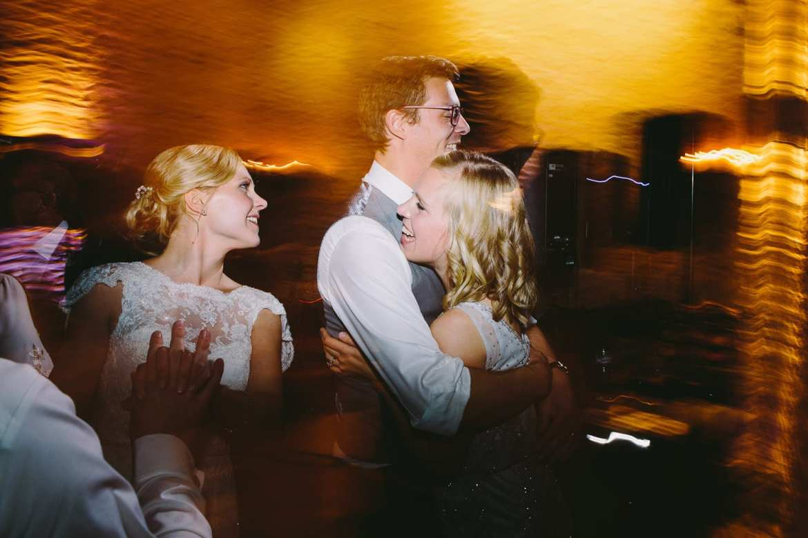 Dancing shots with bride and bridesmaid