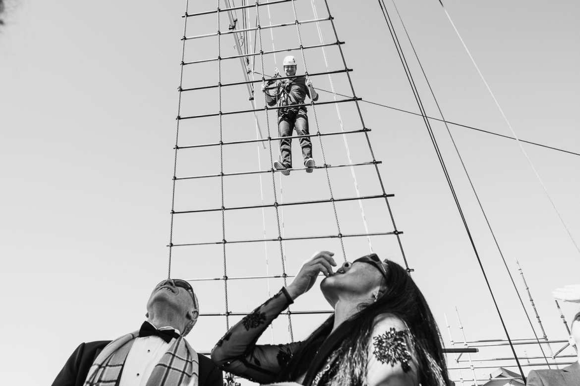Guests watch as a visitor climbs the rigging at the SS Great Britain