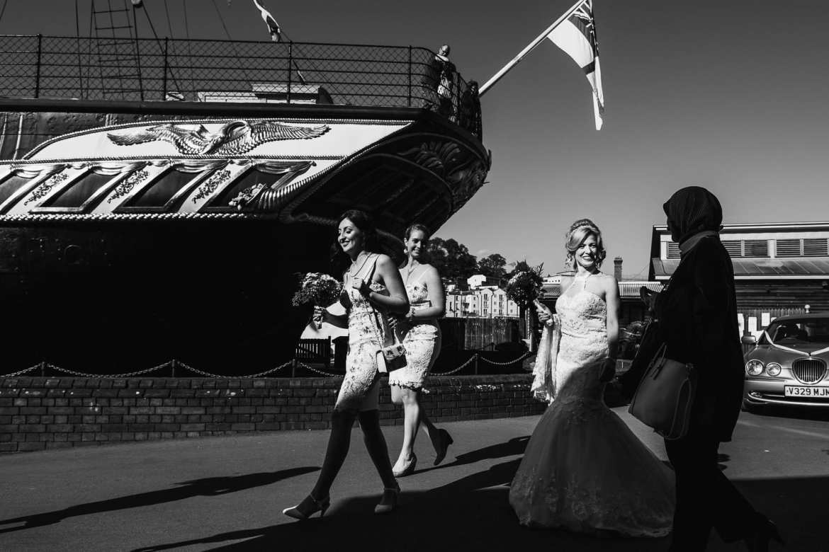The bride and bridesmaids arrive with the SS Great Britain in the background