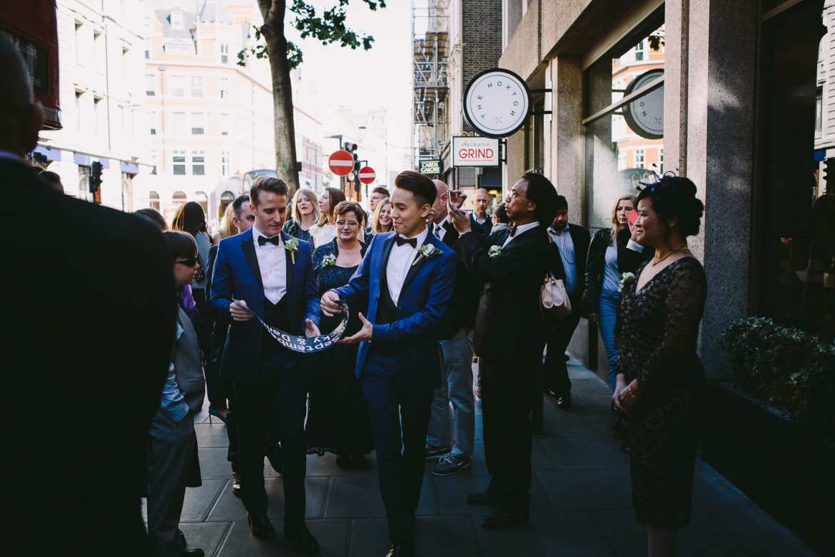 Wedding party arriving back at Hoxton Hotel for reception