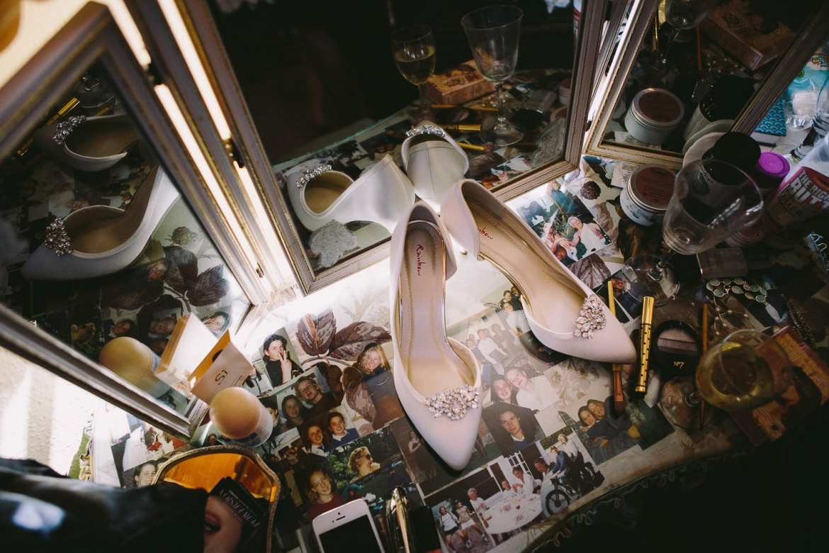 Beautiful wedding shoes on brides dressing table