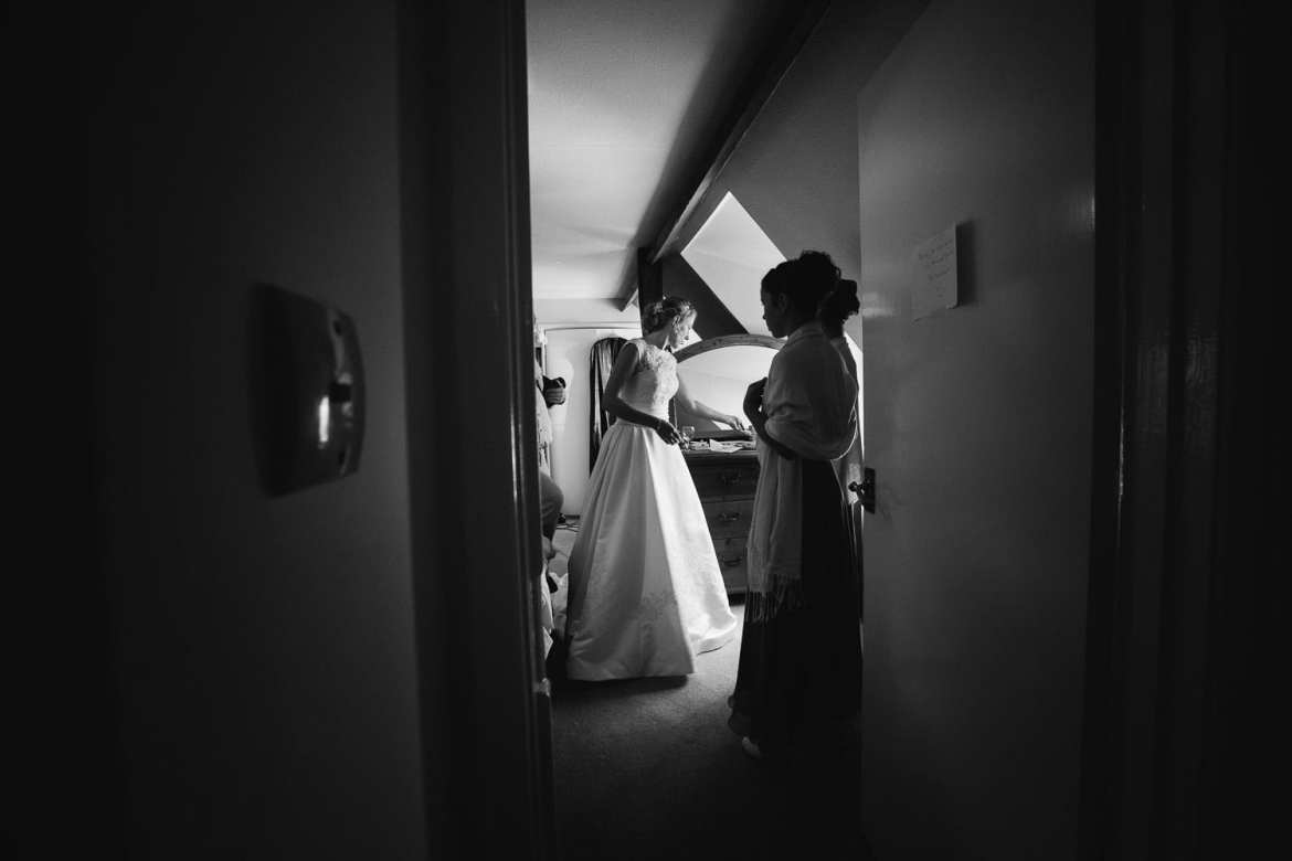 Bride getting ready to leave her bedroom after bridal prep