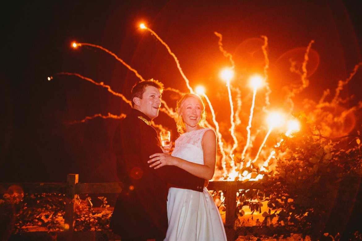 Bride and groom with surprise fireworks