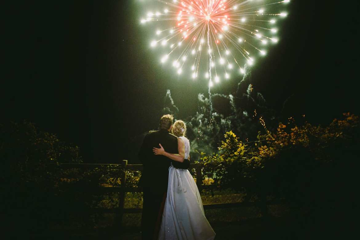 Image of bride and groom with fireworks