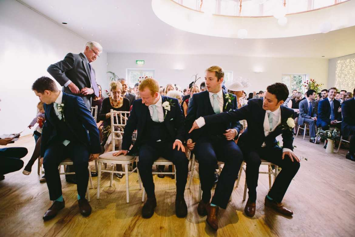 The groom and groomsmen taking their seats before the marriage ceremony