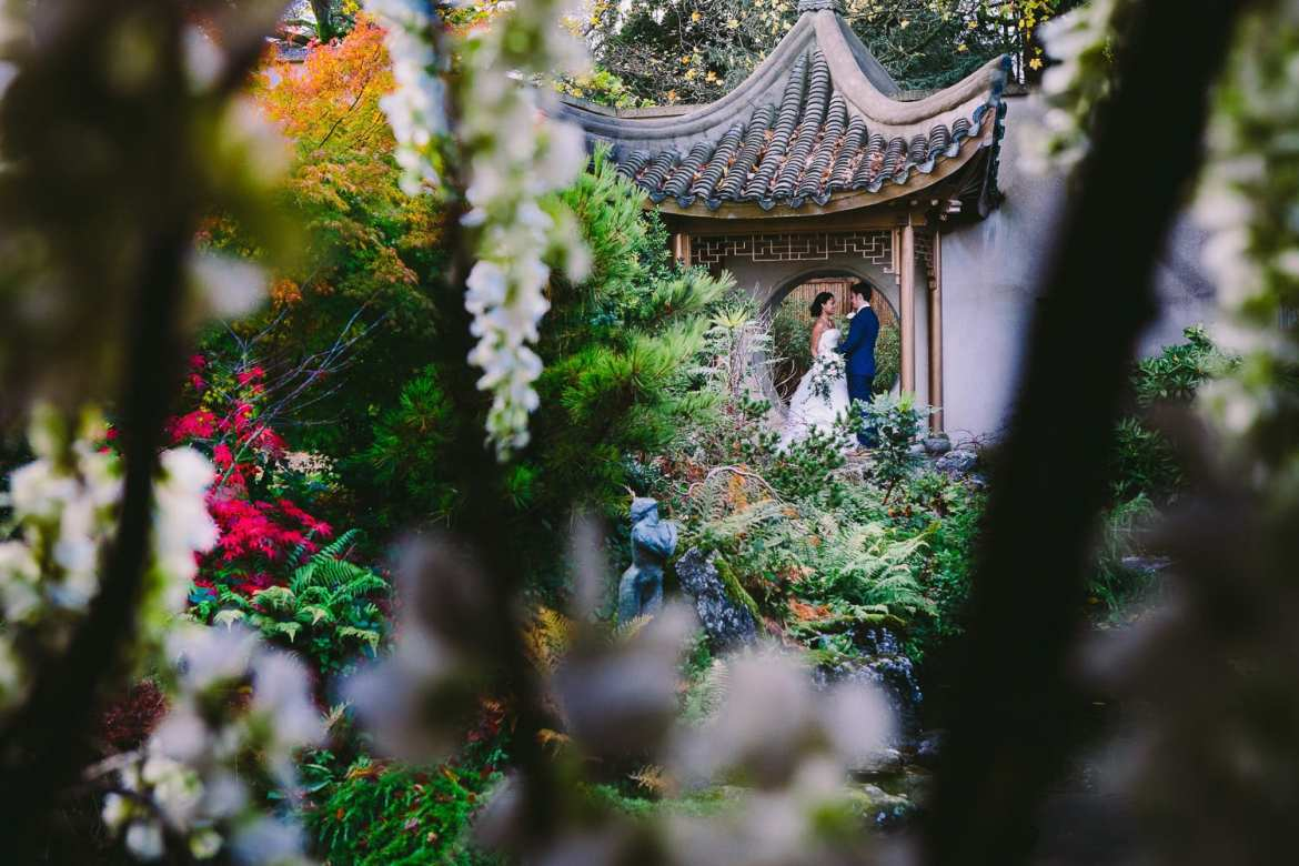 A portrait of the bride and groom in the Japanese garden at the Matara Centre