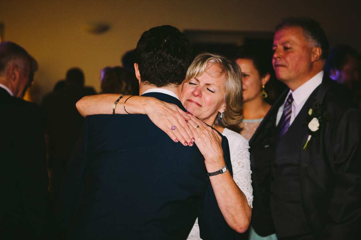 The mother of the groom hugging her son