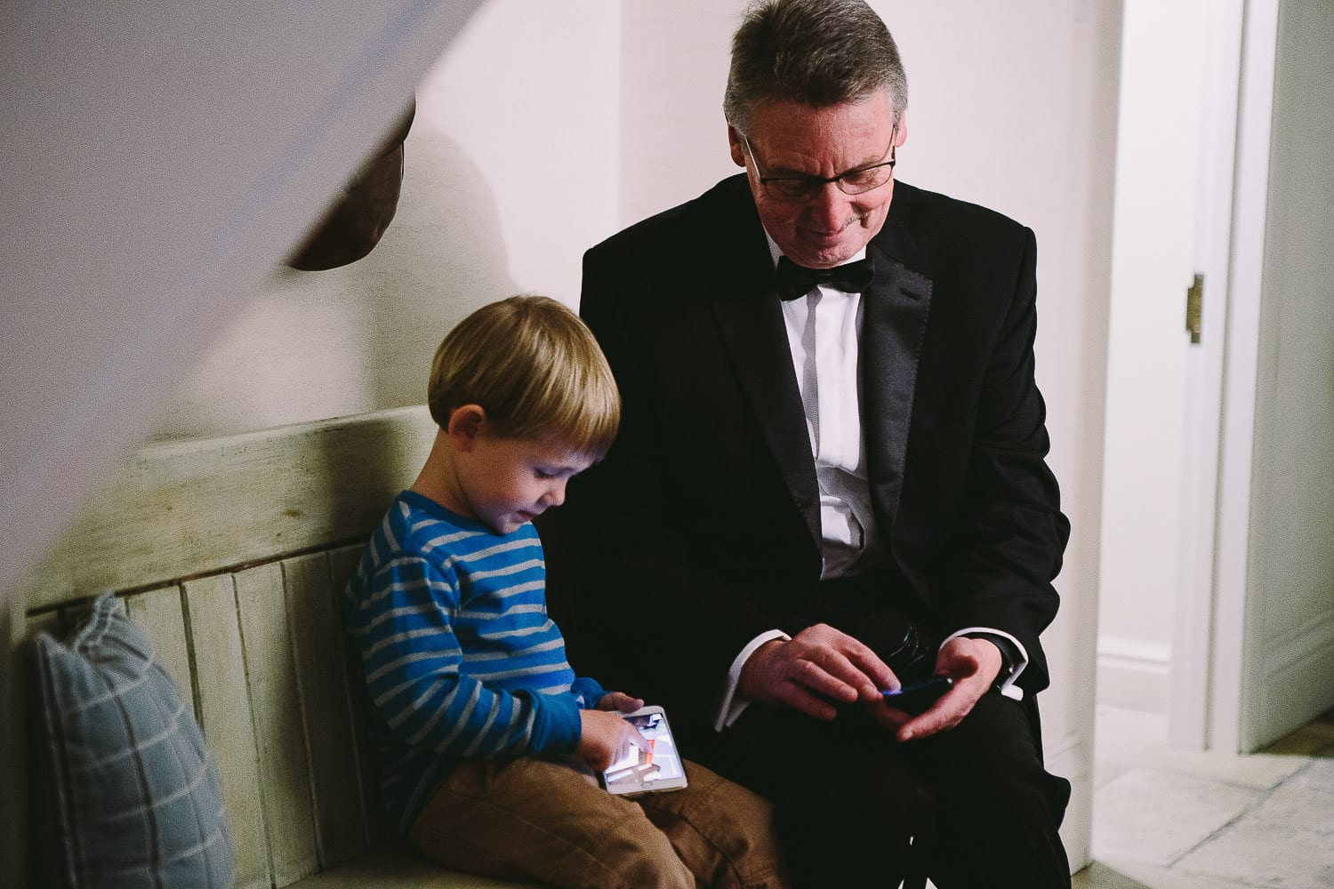 father of the bride sits with the page boy