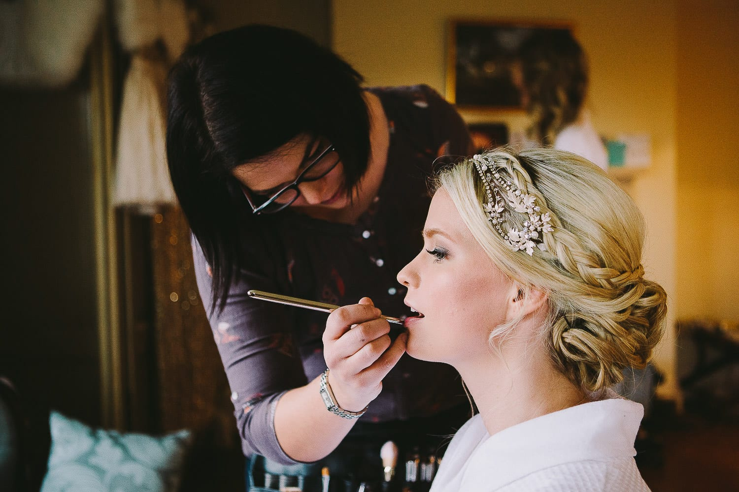 bride having lipstick applied