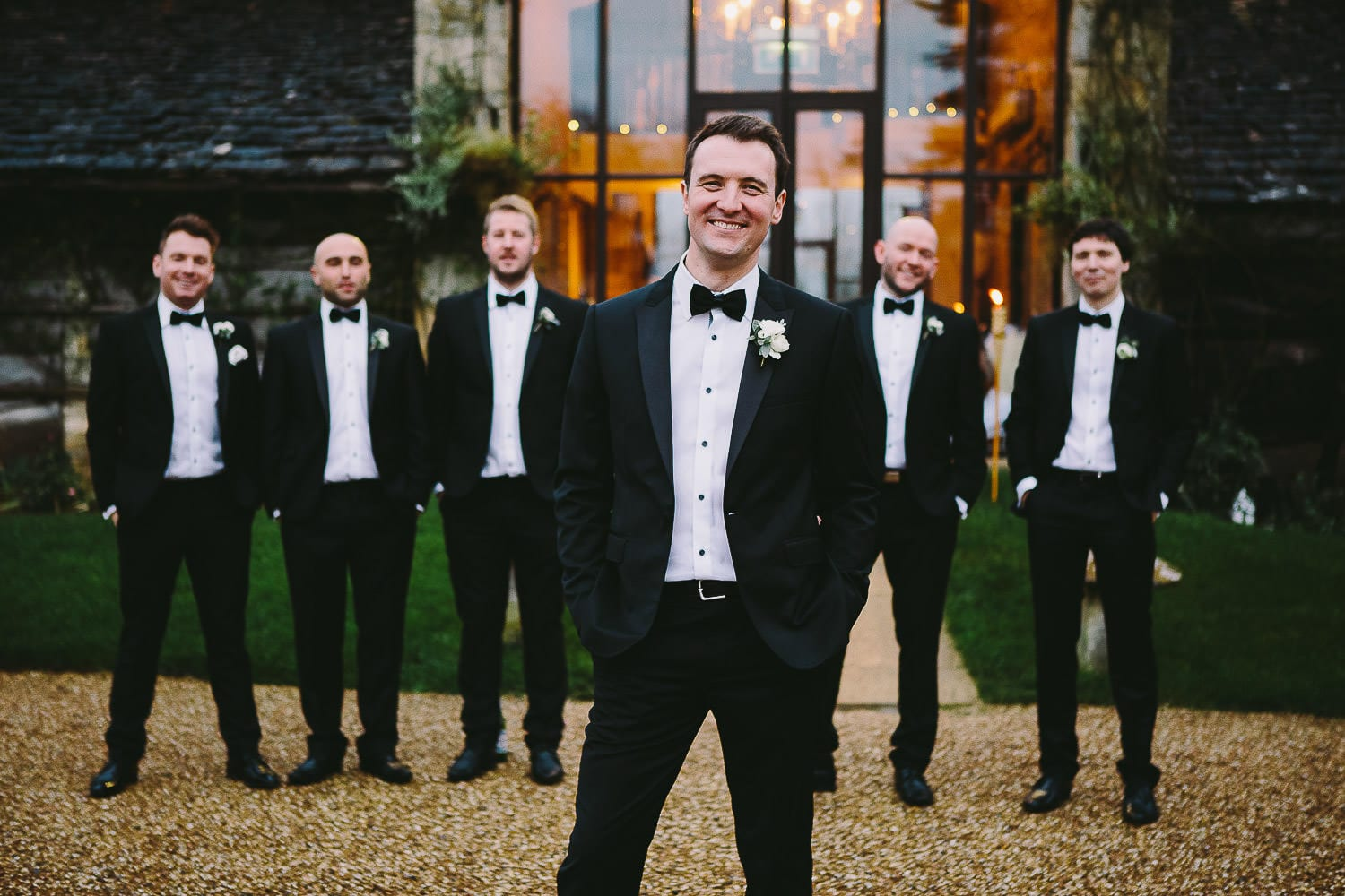 The groom with his groomsmen outside the barn