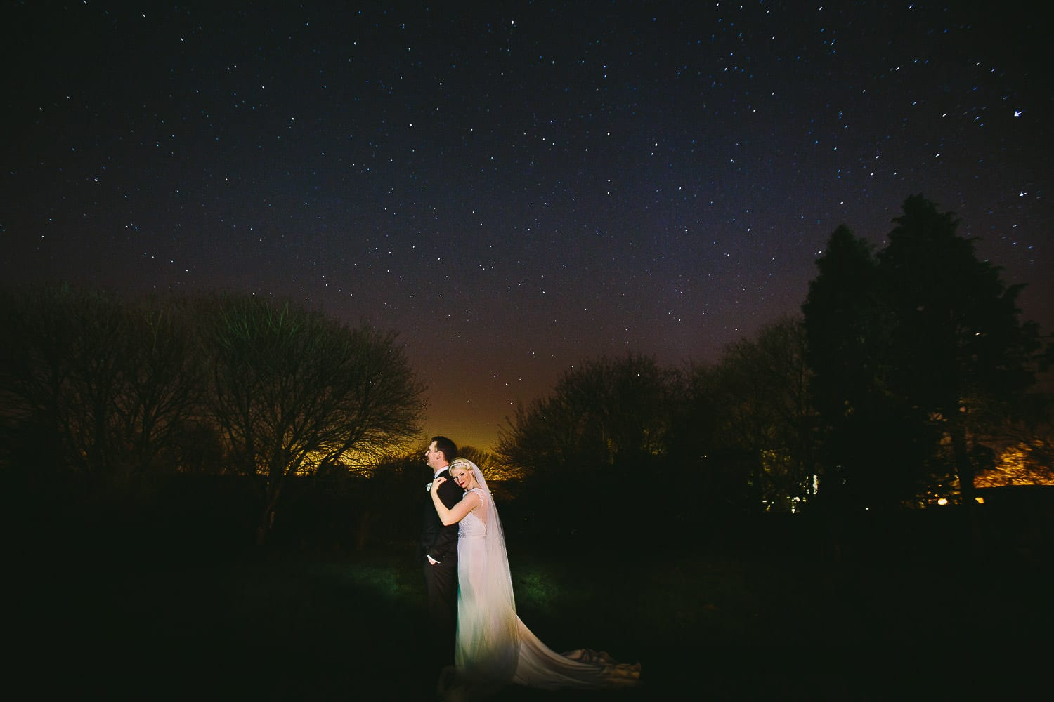 Starry shot of the bride and groom in the gardens