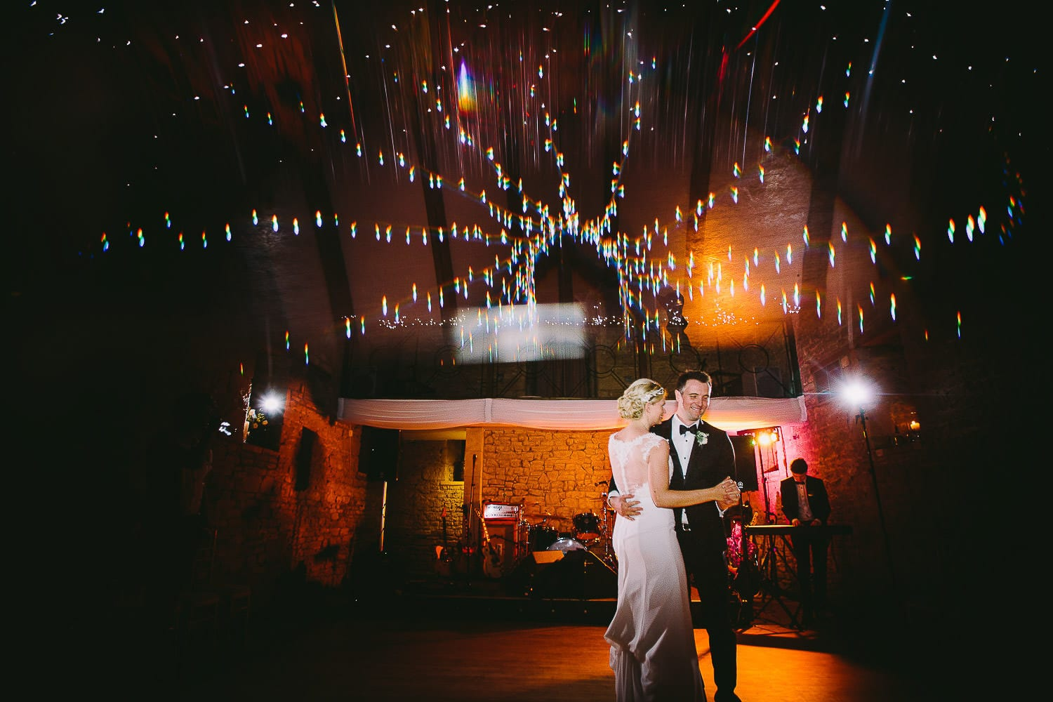Bride and grooms first dance with band behind them